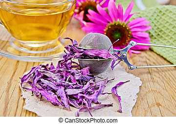 Echinacea dried on paper in strainer with flowers -...