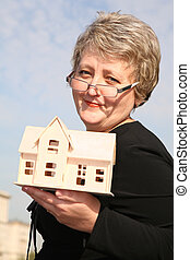 senoir woman with house model
