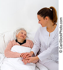 Home care - Elderly woman with her caregiver at home