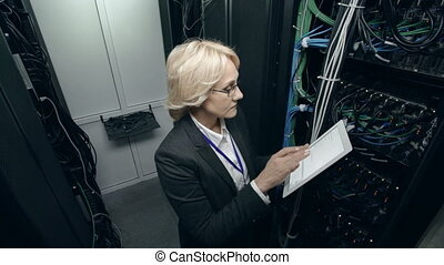 Database Cluster Inspection - Female inspector putting down...