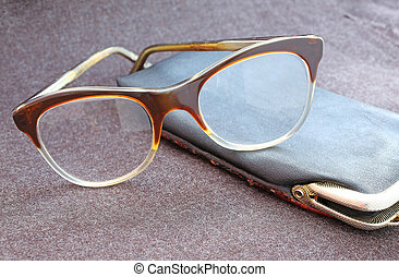 large glasses and black leather case - very large glasses...
