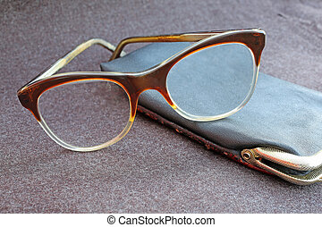an elderly old glasses with black leather case - an elderly...