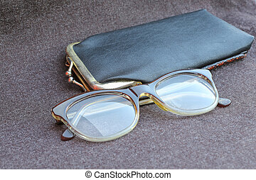 old glasses of an old woman with black leather case -...