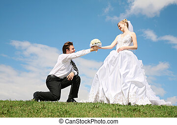 fiance entrusts bouquet to the bride