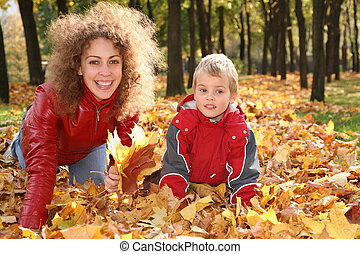 mother with child on maple leaves