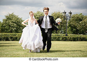 bride with the fiance they run on the lawn