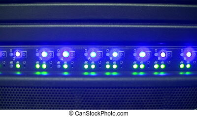 Supercomputing - Close up of server panel illuminated with...