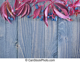 autumn leaves on the wooden background, red leaves