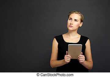 Mature Businesswoman with Digital Tablet over dark...