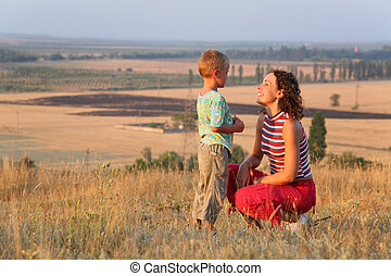 Mum looks at the son on the nature