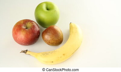Fruit face. - Rotating happy face made out of two apples, a...