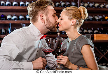 Couple having romantic wine tasting at the cellar - Young...