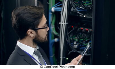People of Science - Handsome man checking server work...