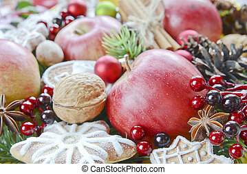 Christmas background from the red apples, cookies and spices