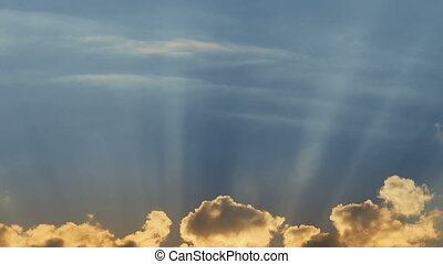 Heavenly clouds with sun rays - Timelapse shot of the...