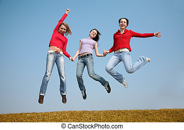 three jumping girls