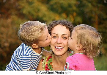 children kiss the mother