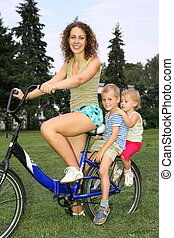 mother with children on bike