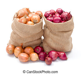 Red and yellow onions in burlap sack
