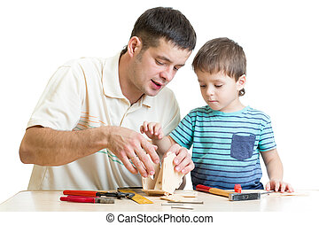Dad and son kid make nesting box together