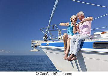Happy Senior Couple Sitting On a Sail Boat - A happy senior...