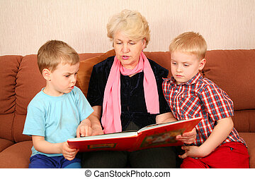 The grandmother and grandsons read the book