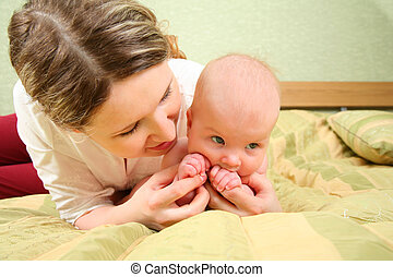 Mother is played with the baby