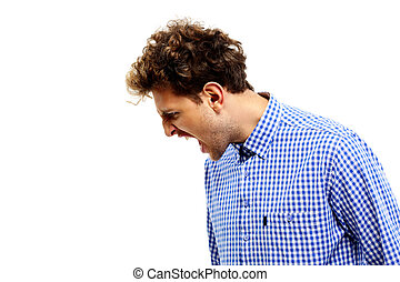 Side view portrait of a man shouting over white background
