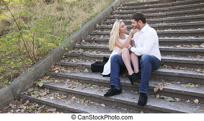 Couple sitting on stairs nature - Camera on steadicam...