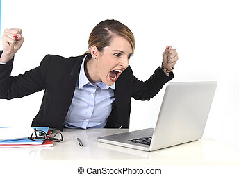 hectic businesswoman excited working at computer laptop on...