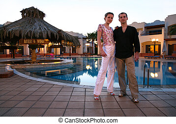 Couple in  the evening hotel