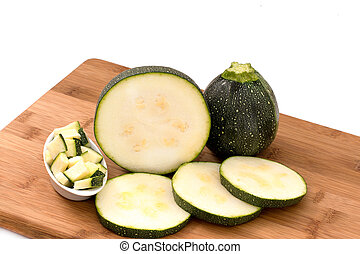 Courgettes - Round Courgettes, Whole, slice on a wooden...