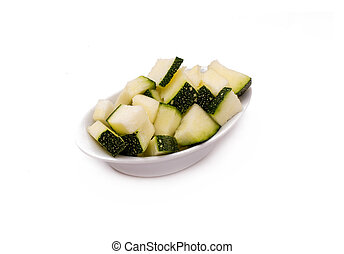 Courgettes - Isolated Courgettes, in a white dish.