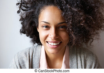 Portrait of a beautiful young african american woman smiling...