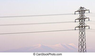 Pylon view - high voltage pylon and snow mountain