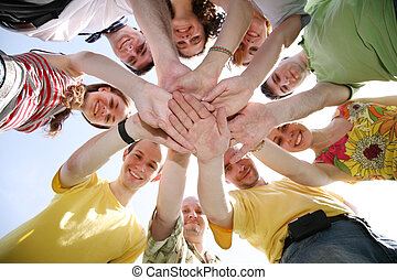 Group of nine friends keep for hands