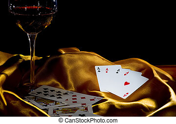 poker ace and wine - poker ace and a glass of wine on a...