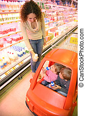 mother with the children in the supermarket