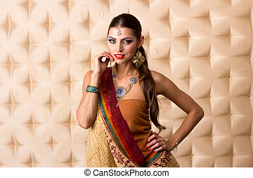 European woman posing in Indian Style, isolated on  white