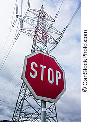 power line and stop sign - a poles of a power line and a...