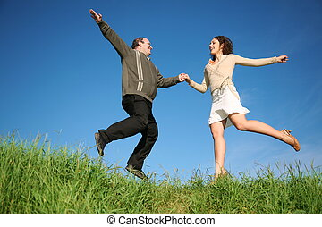 man woman jumping