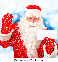Santa Claus with Blank Paper on the Winter Background