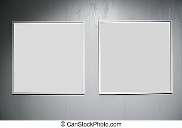 two frames on white wood wall