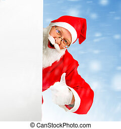 Happy Santa Claus behind Empty White Board on the winter...