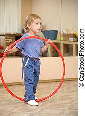 little girl and hoop
