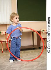 little girl play with hoop