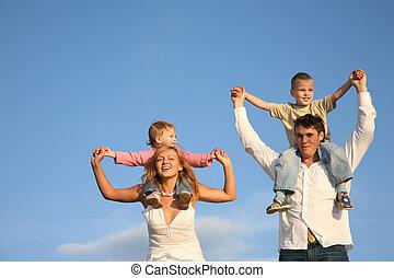 children on shoulders