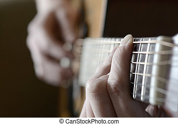 Playing Guitar Strings and Frets - Playing guitar strings...