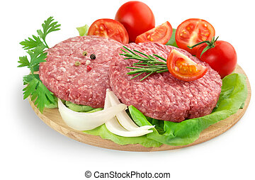 raw burger, vegetabels and herbs - raw burgers, tomatoes and...