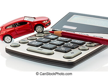 auto, red pencil and calculator - a car and a red pen is on...
